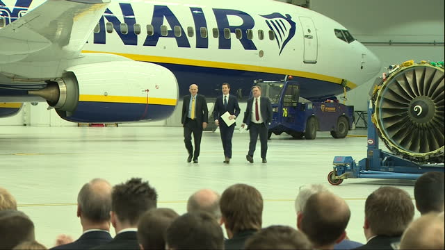 interior shots of george osborne mp vincent cable and ed balls walking across hanger in stansted airport with ryanair plane in background for speech... - george osborne stock videos & royalty-free footage