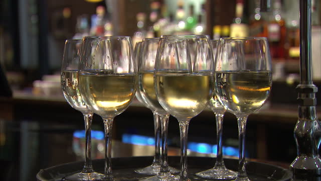 interior shots of glasses of wine and beer being served in a pub on august 24 2015 in london england - wine stock videos & royalty-free footage