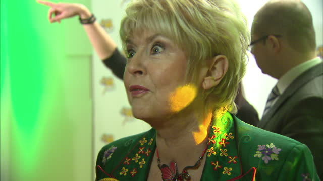 interior shots of gloria hunniford at the premiere of the wizard of oz at london palladium on march 1, 2011 in london, england. - gloria hunniford stock-videos und b-roll-filmmaterial