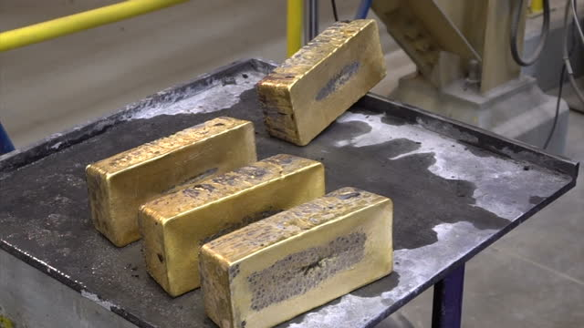 Interior shots of gold ingots being cooled in tanks of water and cleaned after being cast at the Barrick Nevada gold mining operation >> on September...