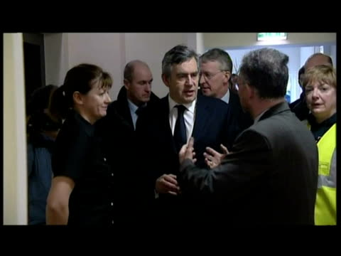 interior shots of gordon brown meet greet cockermouth officials interior shots gordon brown chatting to people affected by floods - gordon brown stock videos & royalty-free footage