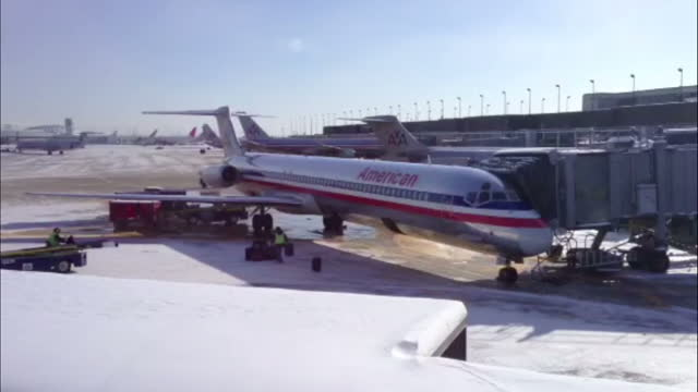 Interior shots of grounded planes snow on the airfield stranded passengers at Chicago O'Hare airport Flights were stopped after Arctic air swept...