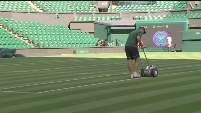 interior shots of grounds keeping staff preparing centre court ahead of wimbledon 2018 shot on 2 july 2018 in wimbledon, england - grass stock videos & royalty-free footage