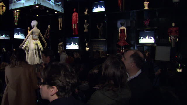 interior shots of guests attending a previews of the alexander mcqueen 'savage beauty' exhibition at the victoria and albert museum>> on march 12... - victoria and albert museum london stock videos & royalty-free footage