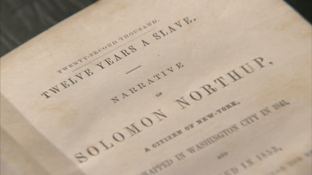 Interior shots of hands flicking through an early edition of Solomon Northup's 'Twelve Years a Slave' in the Saratoga Springs History Museum on March...