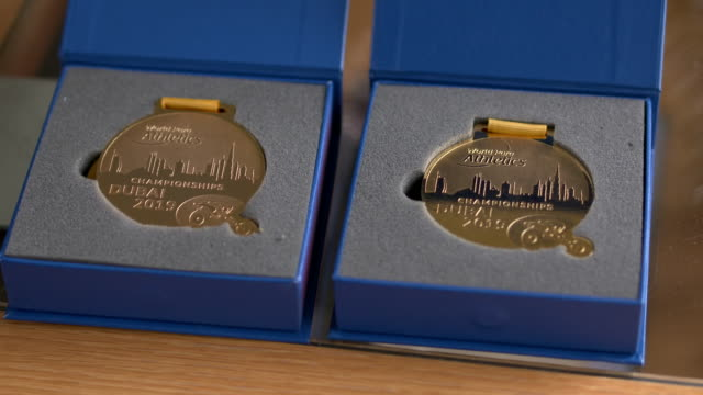 clean interior shots of hannah cockroft's gold medals that she won at the 2019 dubai world championships shot in her home on january 13th 2020 - championships stock videos & royalty-free footage