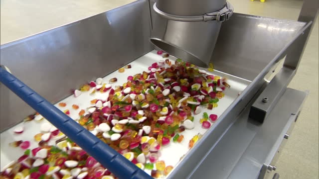 Interior shots of Haribo sweets tumbling from a chute and going along a production line in a factory on 7 July 2017 in Castleford United Kingdom
