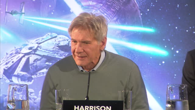 interior shots of harrison ford answering question at press conference for star wars the force awakens about whether he ever hums the star wars tune... - an answer film title stock videos & royalty-free footage
