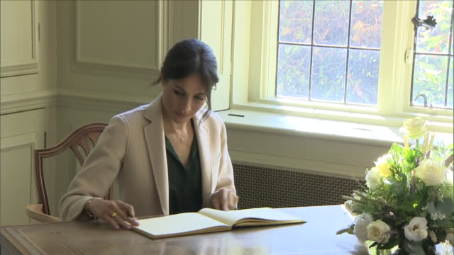 interior shots of harry and meghan, the duke and duchess of sussex signing the guest book at edes house,including a view of their signatures and a... - writing stock videos & royalty-free footage