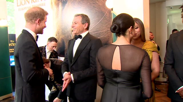 interior shots of harry duke of sussex and meghan duchess of sussex talking to ceo of disney bob iger and his wife willow bay at the european... - prince harry stock videos & royalty-free footage