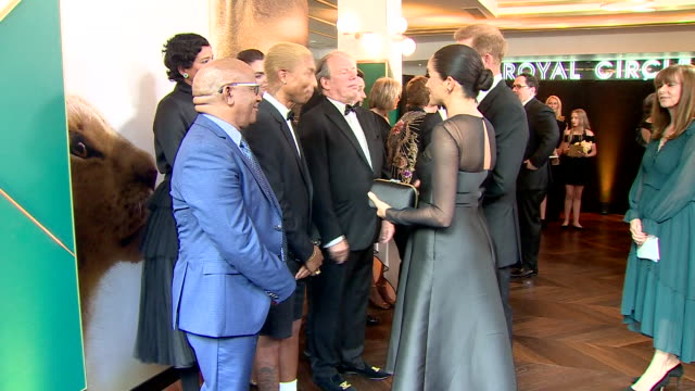 interior shots of harry duke of sussex and meghan duchess of sussex talking to composer hans zimmer and musician pharrell williams at the european... - meghan duchess of sussex stock videos and b-roll footage