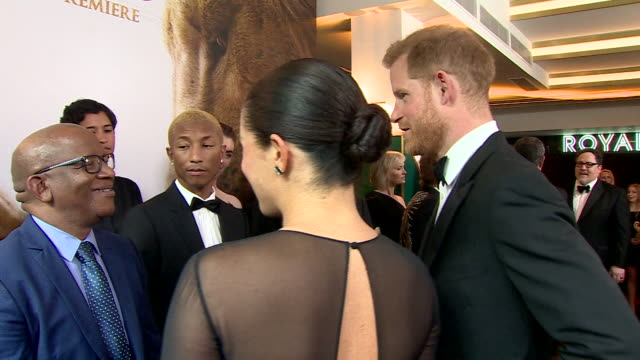 interior shots of harry duke of sussex and meghan duchess of sussex talking to composer lebo m and musician pharrell williams at the european... - meghan duchess of sussex stock videos and b-roll footage