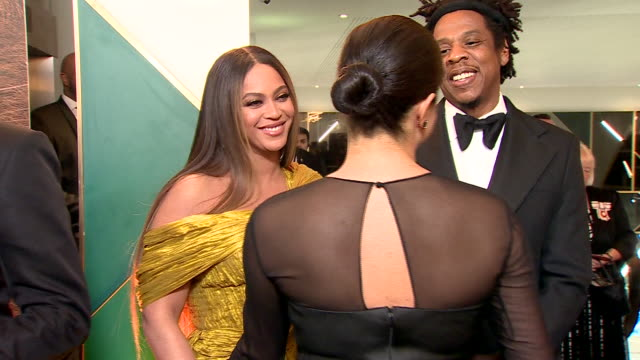 interior shots of harry, duke of sussex and meghan, duchess of sussex talking to beyoncé knowles-carter and shawn corey carter, a.k.a jay-z, at the... - premiere stock videos & royalty-free footage