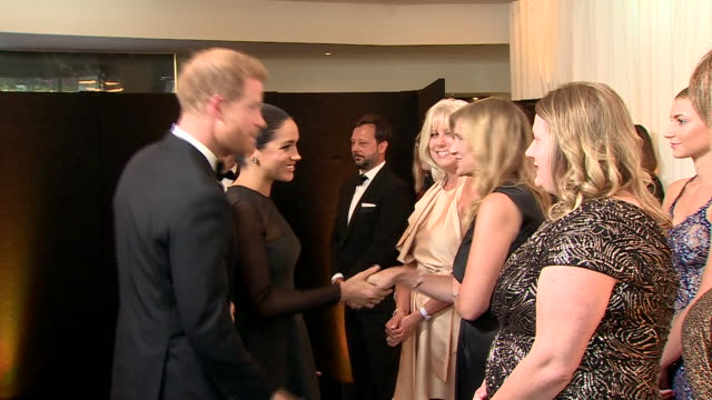 vídeos de stock e filmes b-roll de interior shots of harry duke of sussex and meghan duchess of sussex talking to various people at the european premiere of the lion king at leicester... - meghan markle lion king