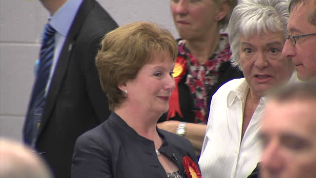 interior shots of hazel blears stood waiting as votes are counted in her salford constituency during the 2010 general elections on may 07 2010 in... - politische gruppe stock-videos und b-roll-filmmaterial