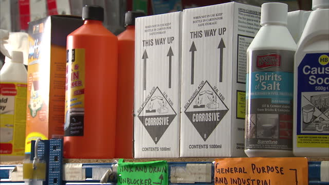 interior shots of high-strength cleaning chemicals, including sulphuric acid and caustic soda, on display in a hardware shop, including close-up... - cleaning agent stock videos & royalty-free footage