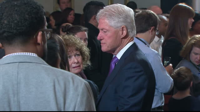 interior shots of hillary and bill clinton speaking to supporters at a press conference at the wyndham new yorker hotel on the day after her election... - bill clinton stock videos and b-roll footage