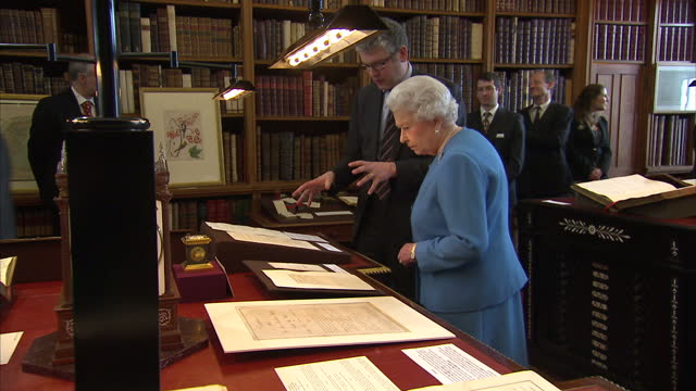 Interior shots of HM The Queen meeting staff in the Royal Library in Windsor Castle and inspecting papers of King George III on April 01 2015 in...