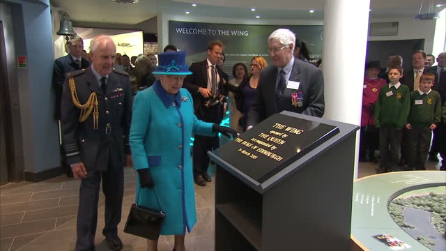 interior shots of hm the queen unveiling a plaque declaring 'the wing' a new visitor centre and museum at the national memorial open on march 26 2015... - memorial plaque stock videos and b-roll footage