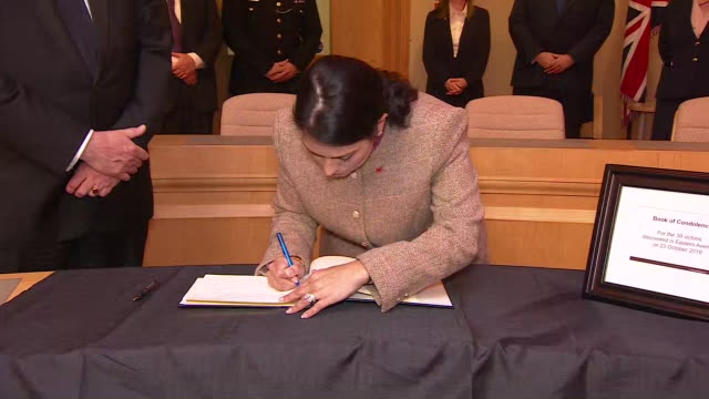 interior shots of home secretary, priti patel signing the book of condolences in memory of the 39 people whose bodies were found in a refrigerated... - film container stock videos & royalty-free footage