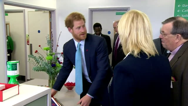 interior shots of hrh prince harry being presented with photo frame & christmas card before saying goodbye to staff & departing mildmay hospital on... - retrovirus video stock e b–roll