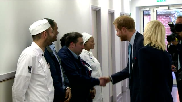 vidéos et rushes de interior shots of hrh prince harry walking through hospital with kerry reeveskneip director of fundraising at mildmay hospital and meeting various... - 2015