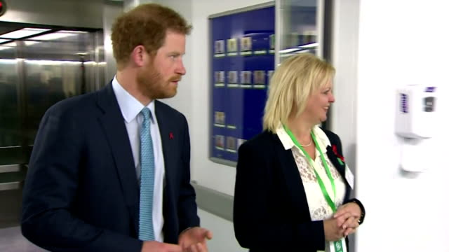 interior shots of hrh prince harry walking through hospital with kerry reeves-kneip, director of fundraising at mildmay hospital and meeting various... - retrovirus video stock e b–roll