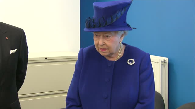 Interior shots of HRH Queen Elizabeth II walk into computer suite meet staff young people at The Prince's Trust Centre on March 08 2016 in Kennington...