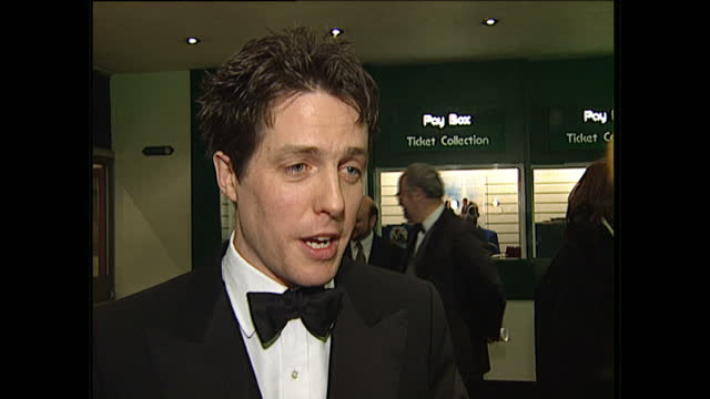 "interior shots of hugh grant being interviewed at the premiere of ""extreme measures"" on january 29, 1997 in london, england. - film premiere stock videos & royalty-free footage"