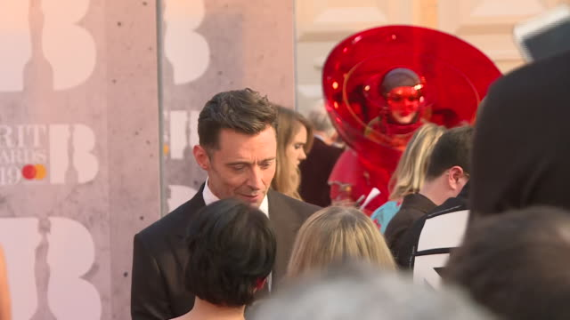 interior shots of hugh jackman chatting to people at the brit awards 2019 held at the o2 arena on february 20 2019 in london england - ブリット・アワード点の映像素材/bロール