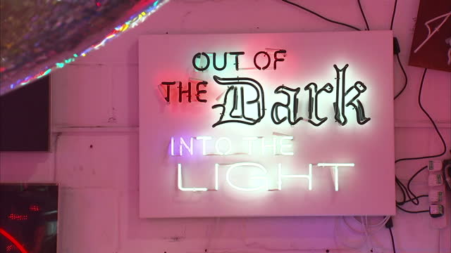 interior shots of illuminated and neon signs on display at gods own junkyard, including shots of brightly coloured lights reflecting off a disco... - neon stock videos & royalty-free footage