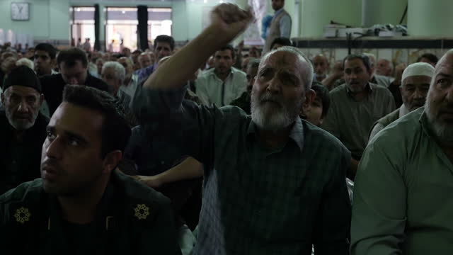 Interior shots of Iranian men in a Tehran mosque shouting 'Death to America Death to Britain' in Arabic on July 29 2016 in Tehran Iran