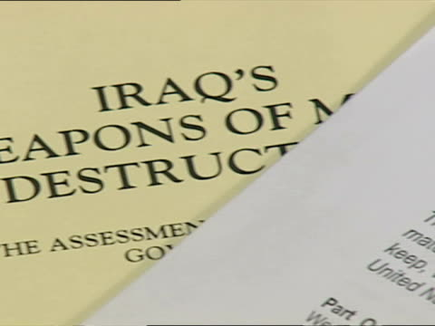 interior shots of iraq dossier detailing the evidence given for weapons of mass destruction against saddam hussein iraq including close ups of text... - weapons of mass destruction stock videos and b-roll footage
