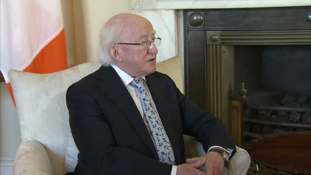 interior shots of irish president michael d higgins and british prime minister david cameron walk into room in no 10 downing street and pose for... - michael d. higgins stock videos and b-roll footage