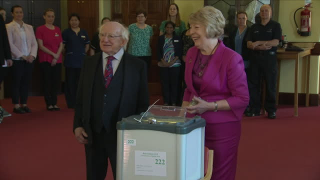interior shots of irish president michael d higgins and his wife sabina casting their votes for the abortion referendum and posting their votes into... - michael d. higgins stock videos and b-roll footage