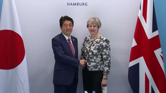 interior shots of japanese prime minister shinzo abe meeting with theresa may on the fringes of the g20 summit the two leaders shaking hands before... - group of 20 stock videos & royalty-free footage