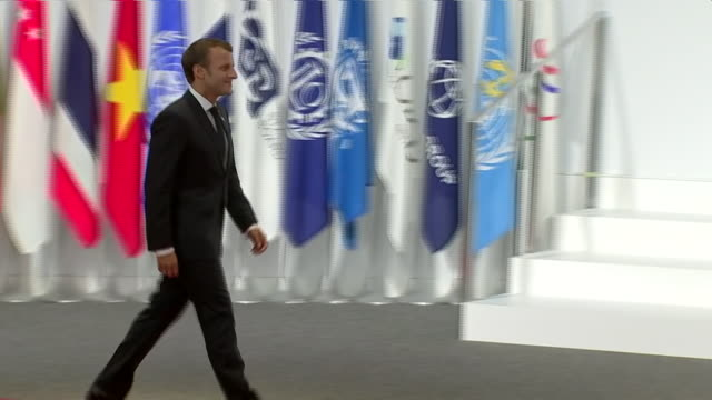 stockvideo's en b-roll-footage met interior shots of japanese prime minister shinzo abe shaking hands with french president emmanuel macron at the g20 summit on 28 june 2019 in osaka... - minister president