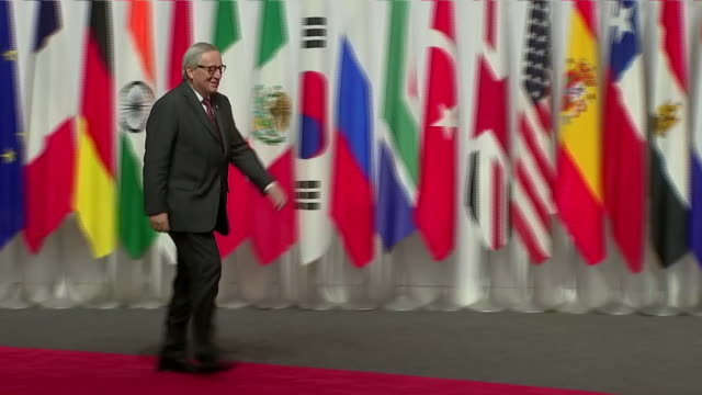 stockvideo's en b-roll-footage met interior shots of japanese prime minister shinzo abe shaking hands with president of the european commission jean claude junker at the g20 summit on... - minister president