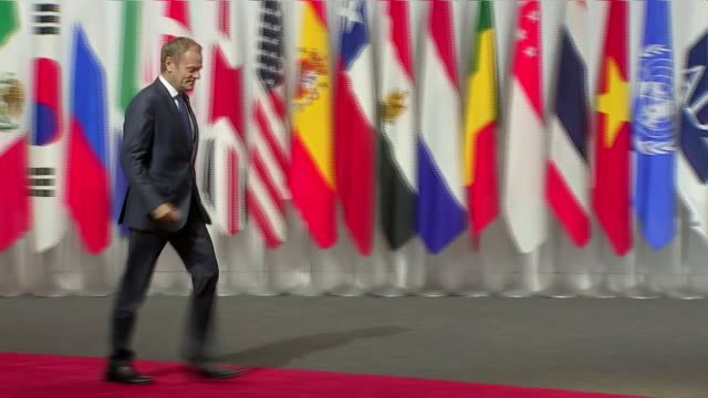 stockvideo's en b-roll-footage met interior shots of japanese prime minister shinzo abe shaking hands with president of the european council donald tusk at the g20 summit on 28 june... - minister president
