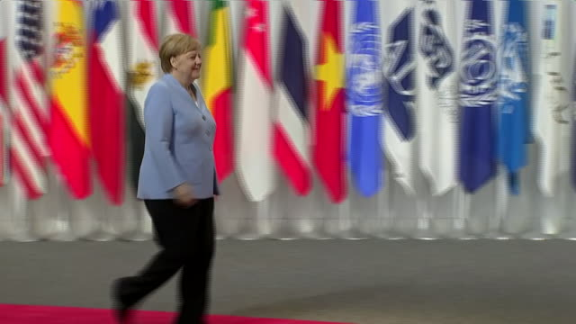 interior shots of japanese prime minister shinzo abe shaking hands with german chancellor angela merkel at the g20 summit on 28 june 2019 in osaka... - angela merkel stock videos & royalty-free footage