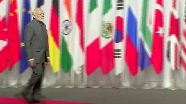 stockvideo's en b-roll-footage met interior shots of japanese prime minister shinzo abe shaking hands with indian president narendra modi at the g20 summit on 28 june 2019 in osaka... - minister president