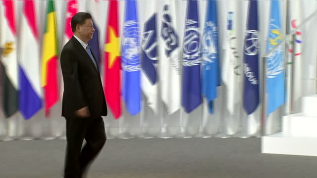 interior shots of japanese prime minister shinzo abe shaking hands with chinese president xi jinping at the g20 summit on 28 june 2019 in osaka japan - präsident stock-videos und b-roll-filmmaterial