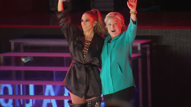 Interior shots of Jennifer Lopez aka JLo meeting Hillary Clinton on stage on December 13 2016 in UNSPECIFIED UNSPECIFIED Region UNSPECIFIED