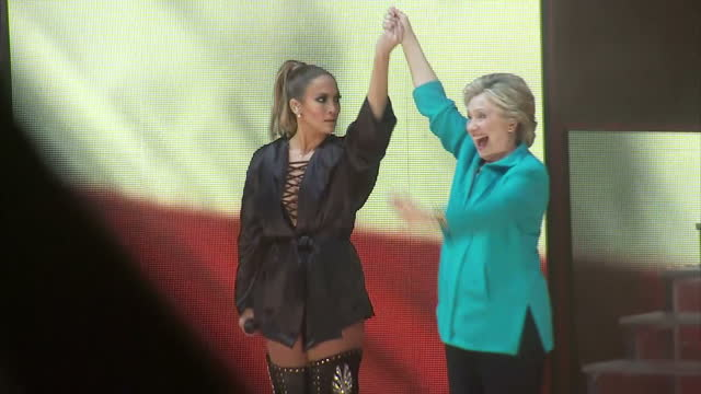 stockvideo's en b-roll-footage met interior shots of jennifer lopez introducing hillary clinton onto stage and marc anthony and hillary clinton addressing fans ahead of the elections... - jennifer lopez