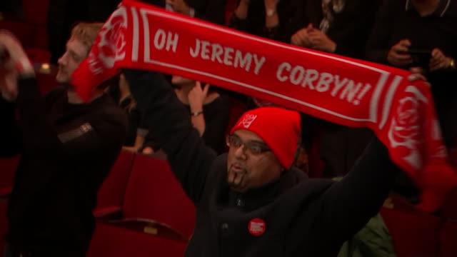 interior shots of jeremy corbyn fan chanting 'oh jeremy corbyn and holding corbyn support scarf, shots of jeremy corbyn posing photos with groups of... - jeremy corbyn stock videos & royalty-free footage