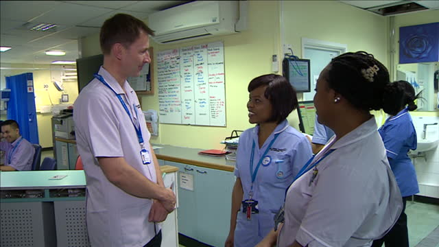 interior shots of jeremy hunt health secretary meeting nursing staff on the marjory warren ward at kings college hospital including closeup shots of... - badge stock videos & royalty-free footage