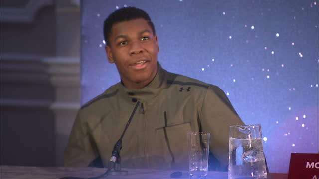 interior shots of john boyega, carrie fisher & daisy ridley answering question at a press conference for star wars: the force awakens about the... - an answer film title stock videos & royalty-free footage