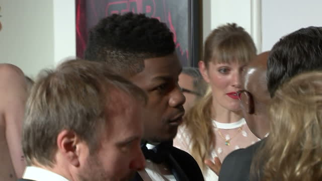 Interior shots of John Boyega chatting with other cast members at the European Premiere of Star Wars The Last Jedi outside the Royal Albert Hall on...