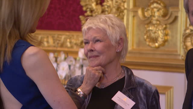 vidéos et rushes de interior shots of judi dench speaking to other guests and officials at a reception for british oscar winners at st james's palace>> on may 04 2016 in... - judi dench