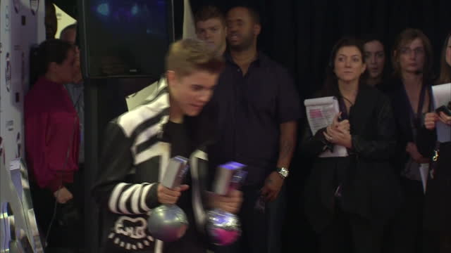 Interior shots of Justin Bieber posing on red carpet with two MTV awards at European MTV Awards Justin Bieber posing at European MTV Awards on...